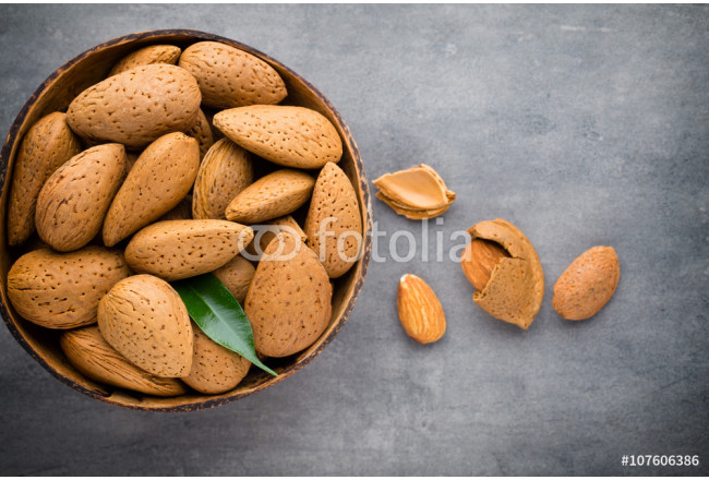 Group of almond nuts with leaves.Wooden background. 64239
