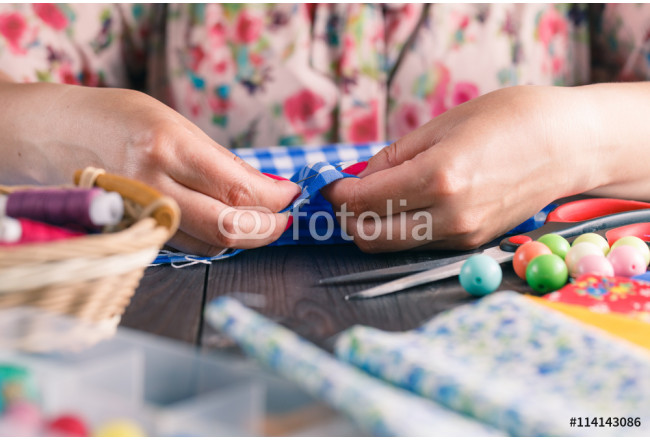 Hand sewing by woman 64239