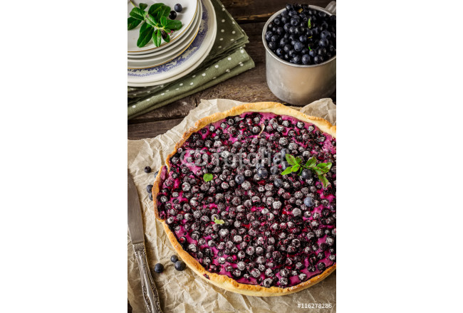 Homemade pie with bilberry  on dark wooden table 64239