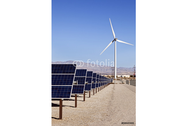 A View of Solar Panels and Wind Turbine in the Field 64239