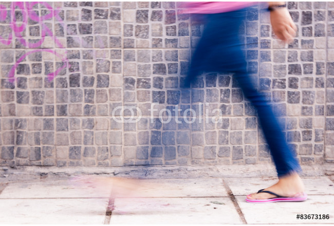 Blurry image of a young woman walking. 64239