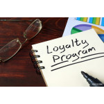 Loyalty Program  concept on a paper with charts. 64239