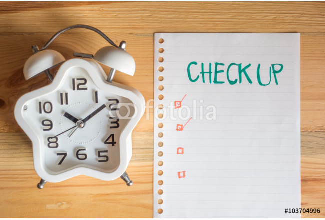 Health check up period concept, top view clock and paper note on wood table 64239