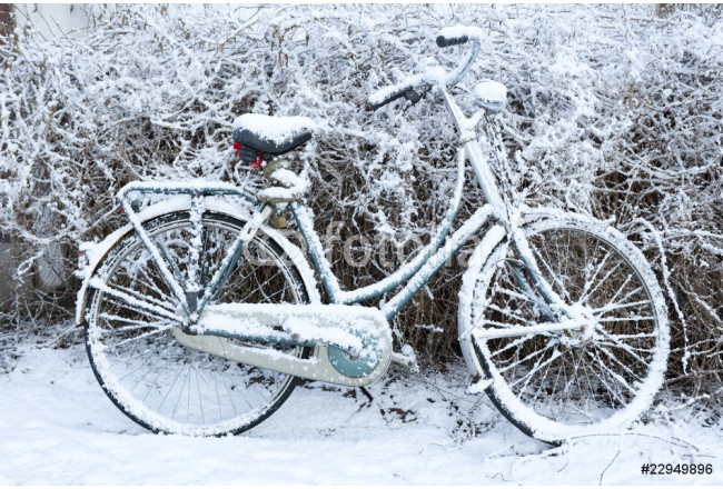 Bicycle coverd by snow in winter 64239