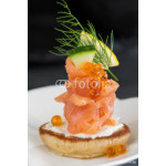 Appetizer with smoked salmon and sour cream, garnished with dill 64239