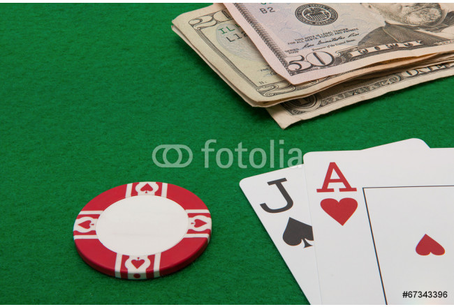 Blackjack hand with Dollar notes and chip on green background 64239
