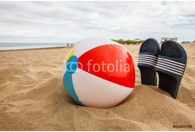 Ball with slipper on the beach 64239