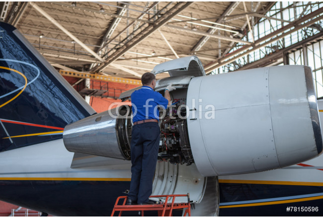 Business jet airplane stays in hangar.. 64239