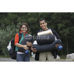 Indian couple carrying camping supplies 64239