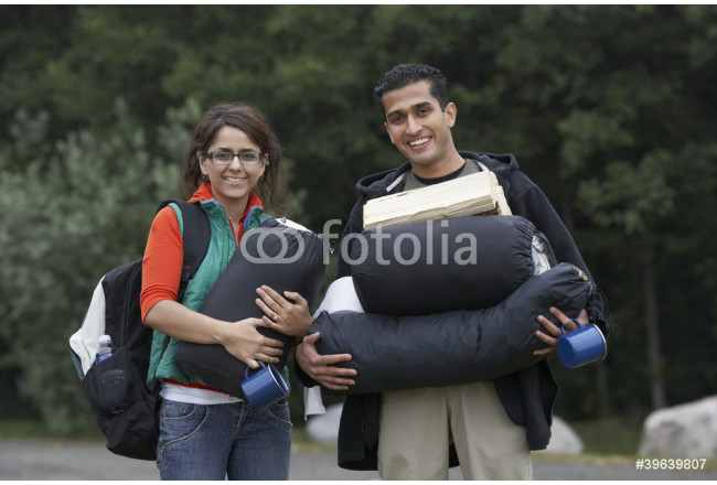 Bild auf Leinwand Indian couple carrying camping supplies 64239