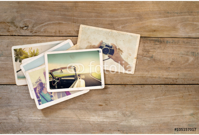 Travel photo album on wood table. instant photo of polaroid camera - vintage and retro style 64239