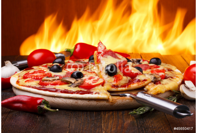 Hot pizza with oven fire on background 64239