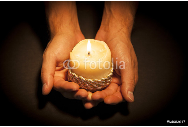 Hands with candle 64239