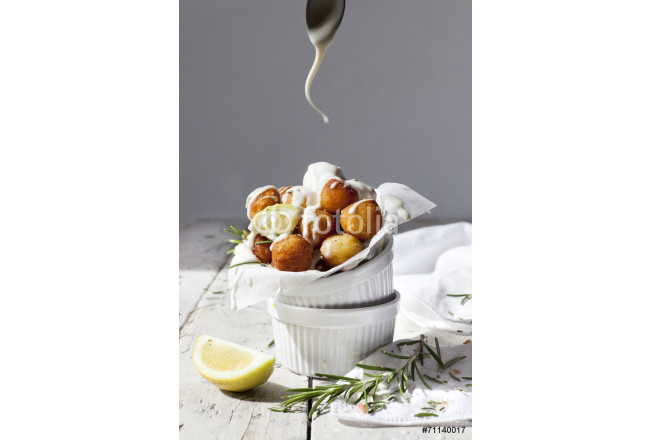 balls of fried potatoes with dripping yogurt sauce from spoon 64239