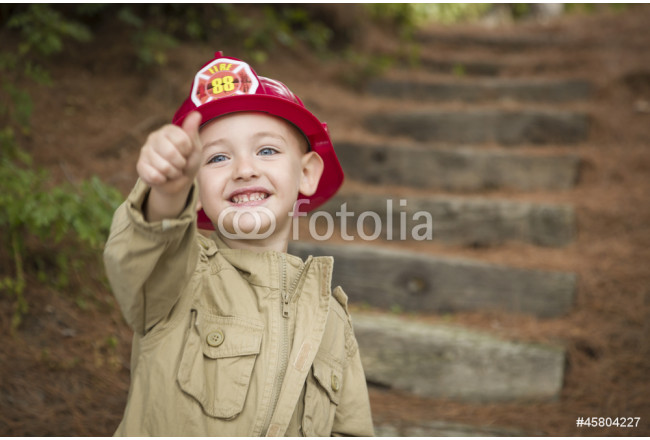 Adorable Child Boy with Fireman Hat Playing Outside 64239