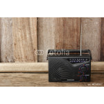 Old transistor radio on wooden background 64239