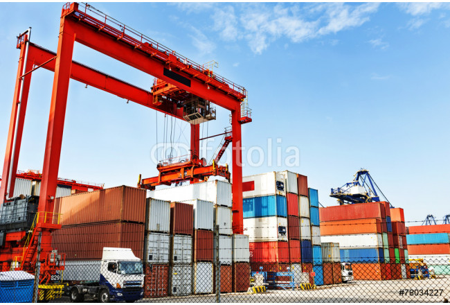 Pier under the blue sky, cranes and containers. 64239