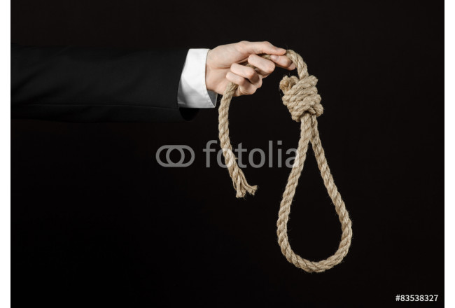 Hand of a businessman holding a loop of rope for hanging 64239