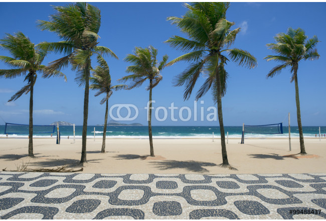 Classic empty view of Ipanema Beach Rio de Janeiro boardwalk with palm trees and blue sky and no people 64239