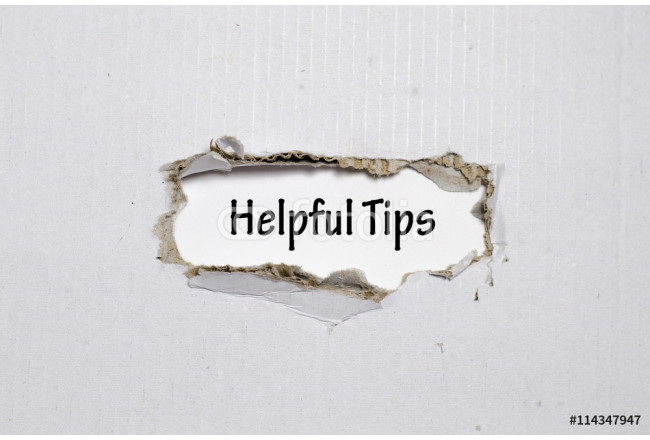 The word helpful tips appearing behind torn paper 64239