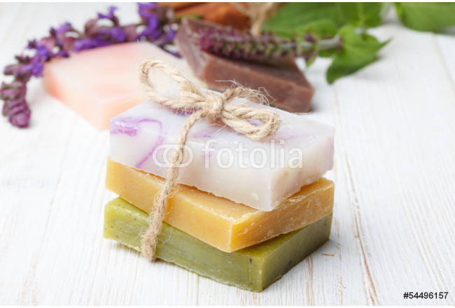 Different natural homemade soap on wooden table with herbs 64239