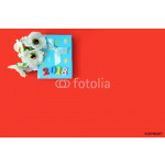 A blue gift box and flowers on a red background 64239