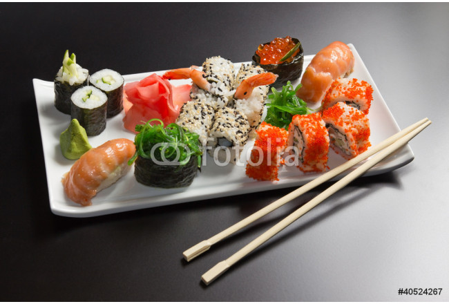 Japanese  seafood  sushi , roll and chopstick on a white plate 64239