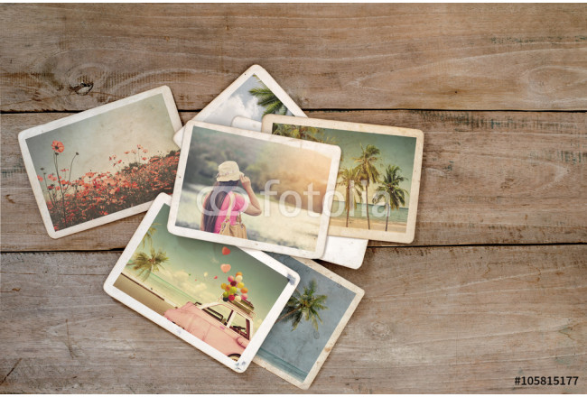 Summer photo album on wood table. instant photo of polaroid camera - vintage and retro style 64239