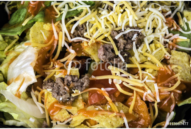 fresh taco salad of seasoned beef lettuce tomato and grated cheese 64239