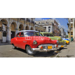 Havana street with colorful old cars in a raw 64239