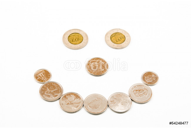 Coins arranged into a happy smiling face using Canadian money 64239