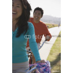 Asian couple riding bicycles 64239