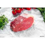 a pieces of fresh meat, beef slab, decorated with greens and vegetables 64239