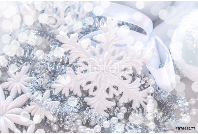Unfocused silver and white snowflake glitter bokeh holiday background. Winter xmas holidays. Christmas.. 64239