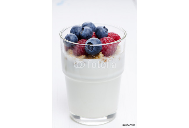 Glass with yogurt and berries close up 64239