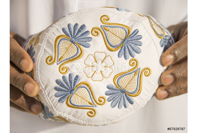 Embroidery on a traditional celebration hat - Africa 64239