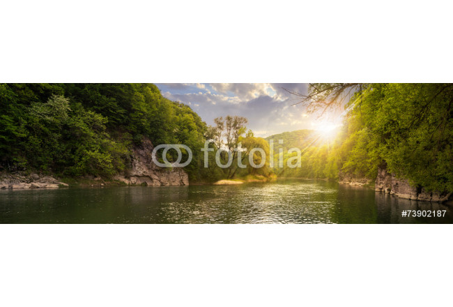 forest river with stones on shores at sunset 64239