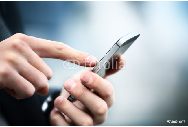 Close up of a man using mobile smart phone 64239