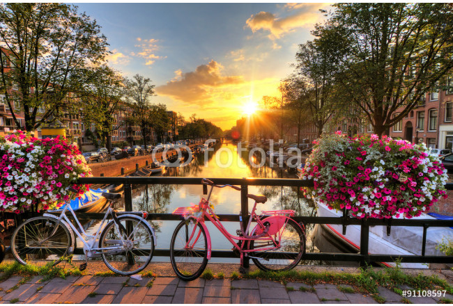 Beautiful sunrise over Amsterdam, The Netherlands, with flowers and bicycles on the bridge in spring 64239