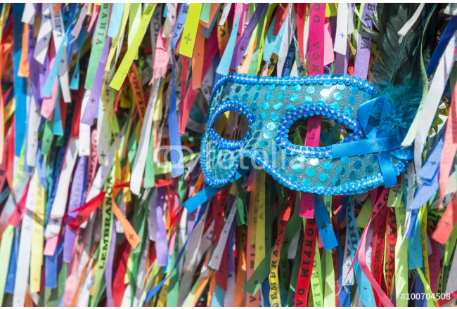 Blue sequined carnival mask in a background of Brazilian wish ribbons Salvador Bahia Brazil 64239