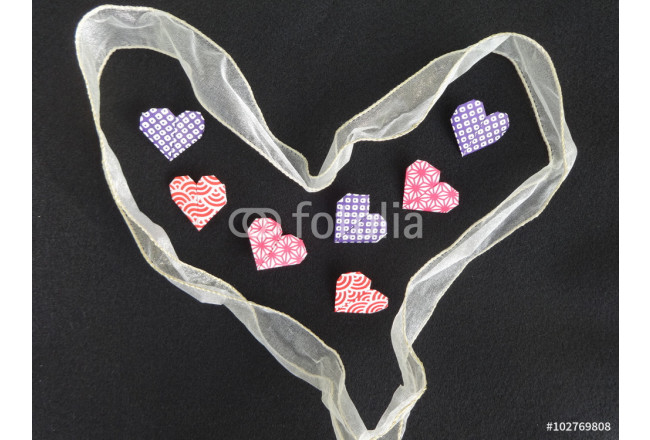Origami hearts surrounded by heart shaped ribbon 64239
