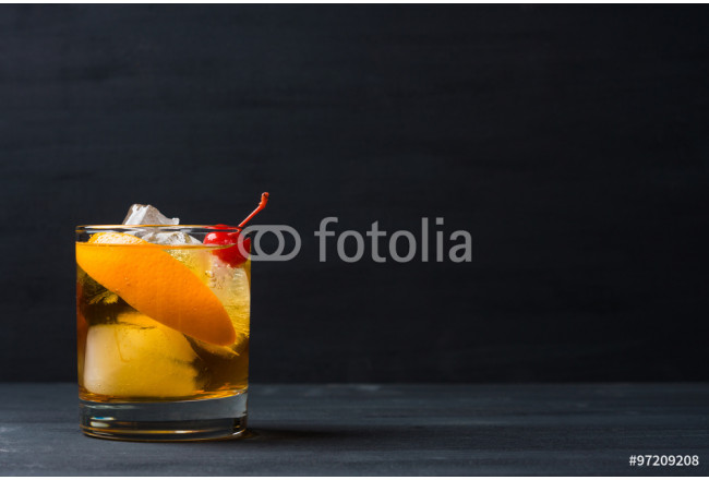 Old fashioned cocktail with cherry and orange peel 64239