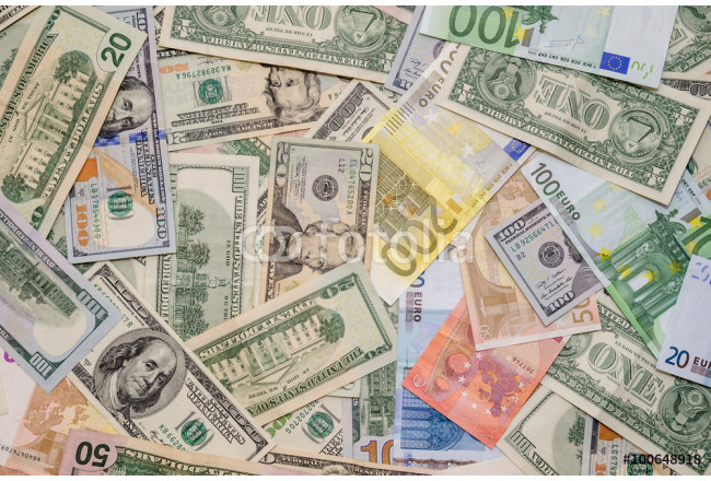 Pile of two leading currencies - US Dollar versus Euro as background 64239
