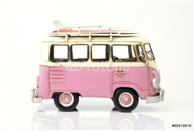 Pink old toy car with surfboard. 64239