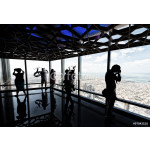 Tourists looking at Dubai cityscape from a high vantage point, U 64239