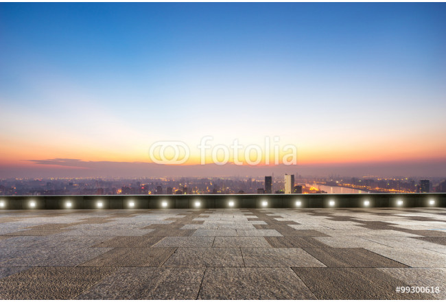 empty floor front of cityscape at sunrise 64239