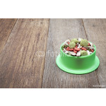 Selective focus, Hamster food in green tray on wooden background, With place for your text 64239