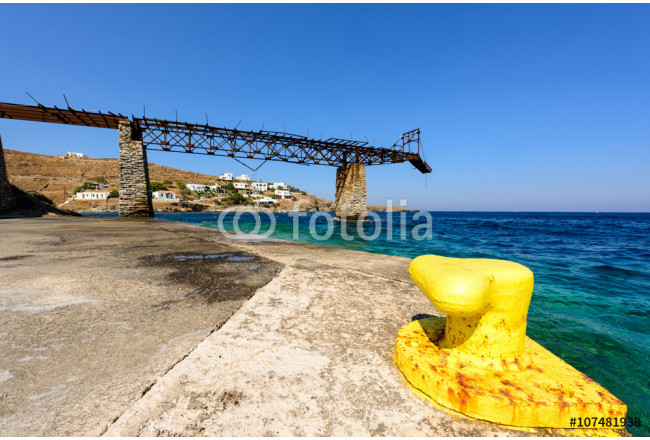 Old gantry projecting out to sea at Loutra port in Kythnos, Greece 64239