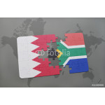 puzzle with the national flag of bahrain and south africa on a world map background. 64239