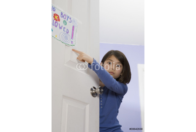 Asian girl pointing at sign on bedroom door 64239